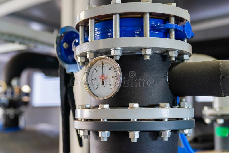 The equipment of the boiler-house, valves, tubes, pressure gauges, thermometer. Close up of manometer, pipe, flow meter, water. Pumps and valves of heating royalty free stock photos