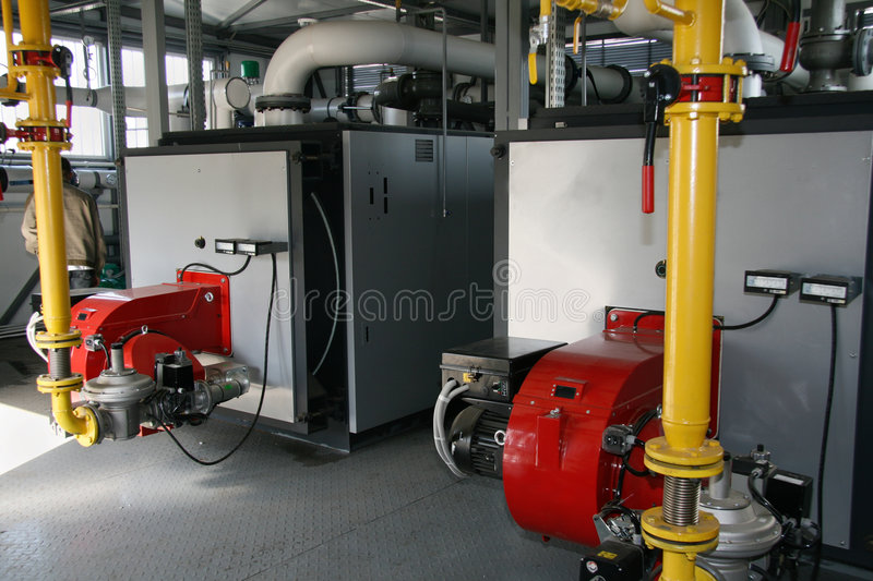 Gas boiler-house. Interior of independent modern gas boiler-house with two steel boilers royalty free stock image