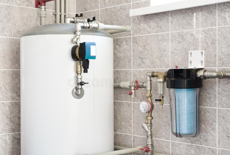 House water heating boiler with pump, ball valves and filters.  stock image