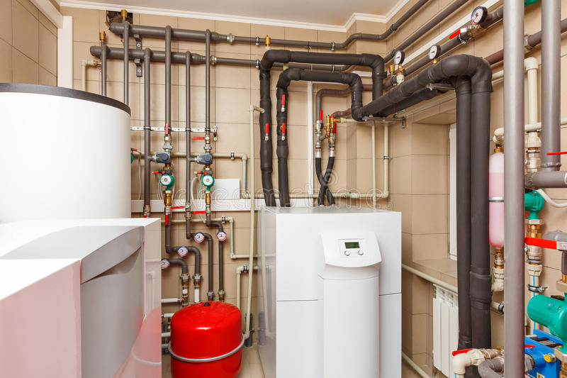 Household boiler house with heat pump, barrel; Valves; Sensors a. Nd an automatic control unit royalty free stock photos