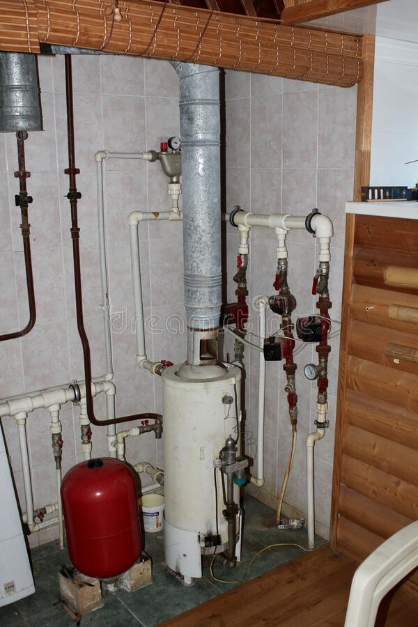 Heating system in a private house from a boiler with plastic pipes stock photography