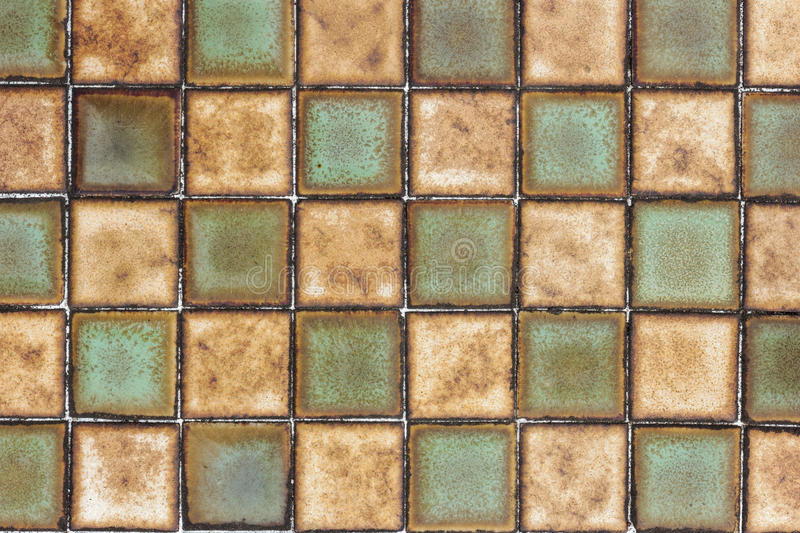 Old wall ceramic tile pattern background. stock photo