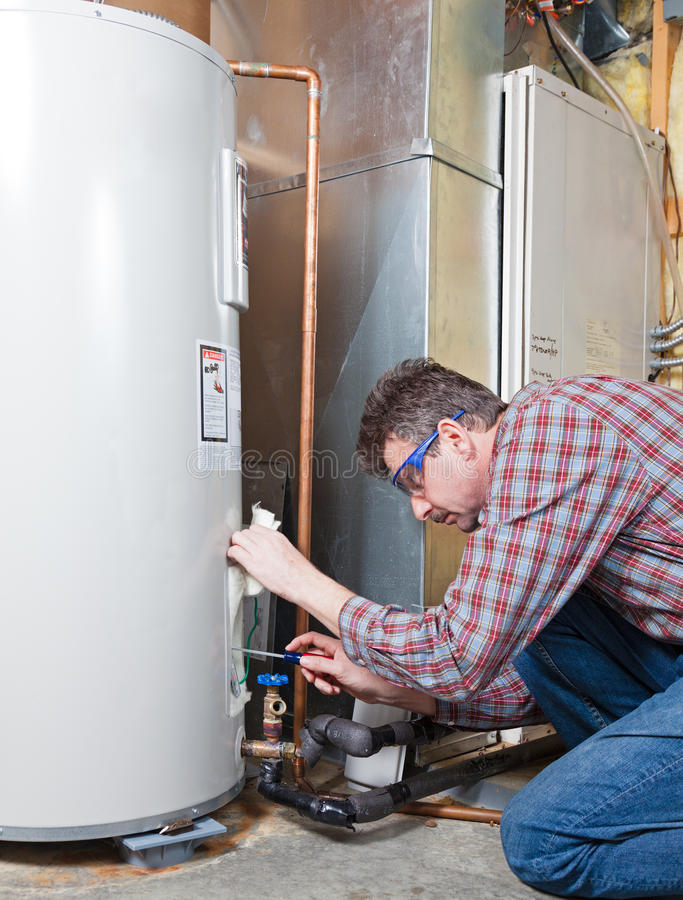 Water heater maintenance royalty free stock image