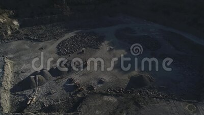 Top view of sand piles and crushing equipment quarry for the extraction of granite and building material stock footage