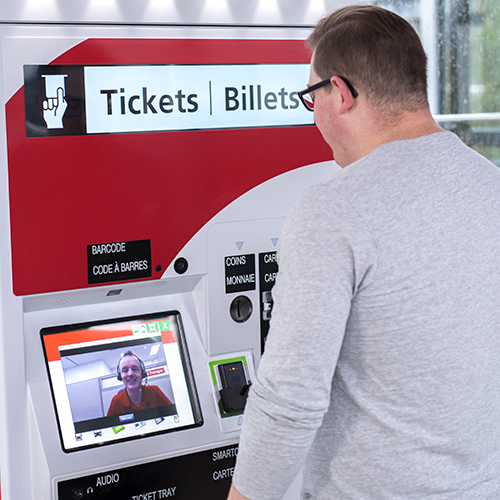 Customer Service Representative speaking with a customer through video chat on a ticket machine.